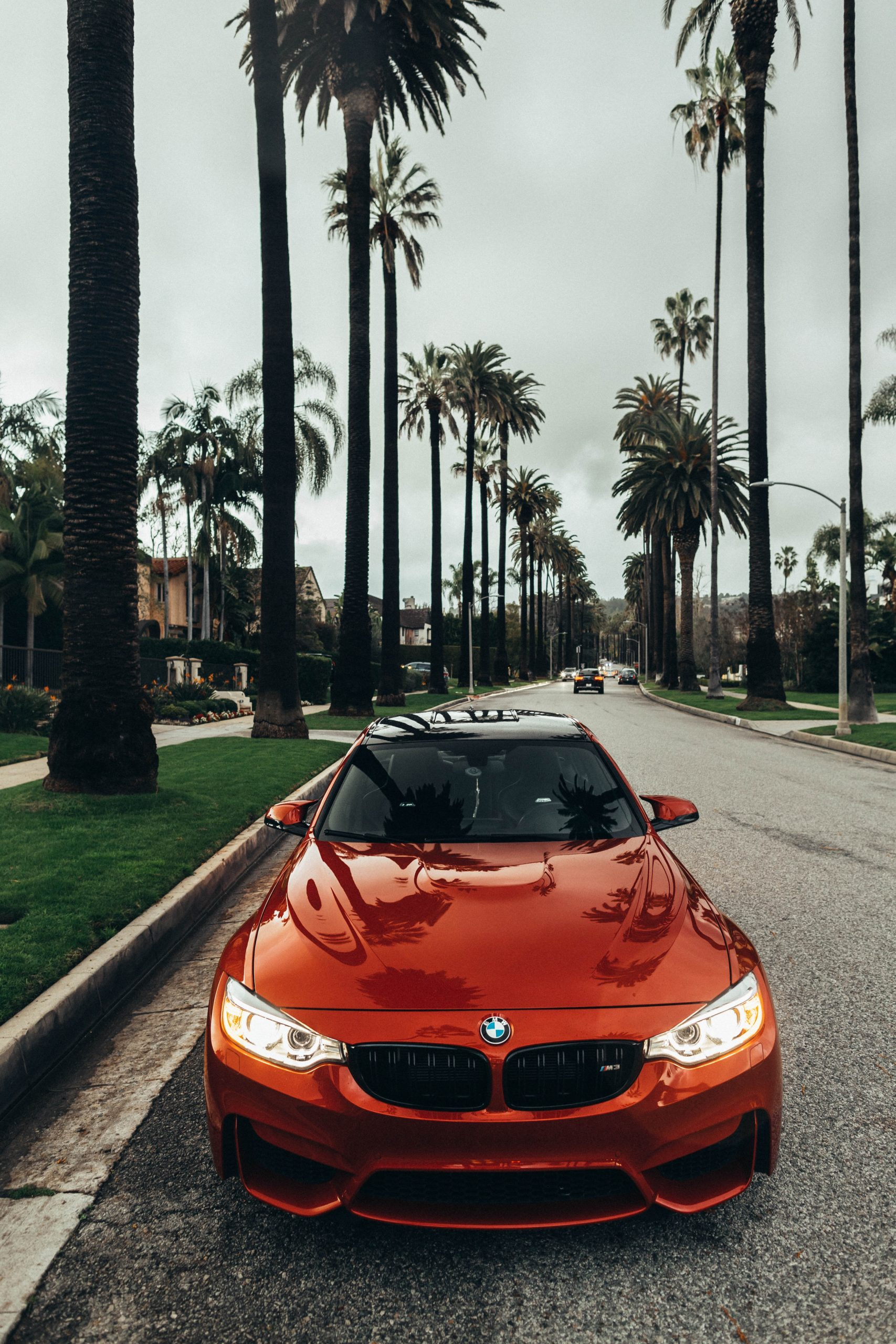 red BMW coupe parked at road